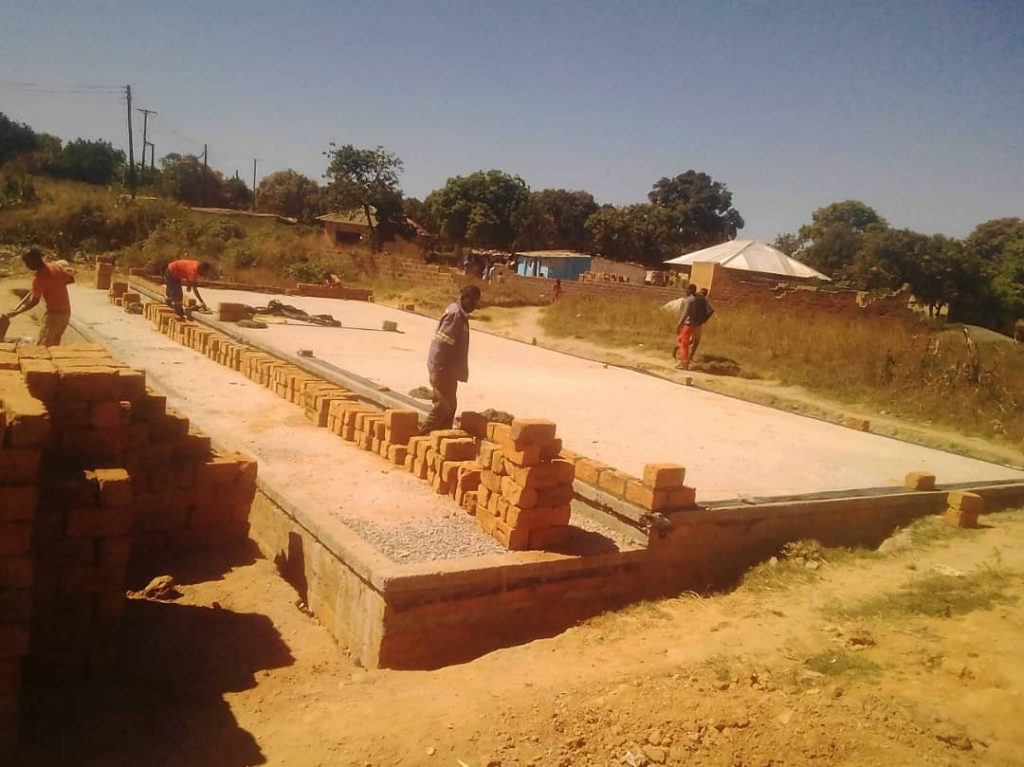 Zambian local workers constructing a small classroom block for the Kamatipa Community School