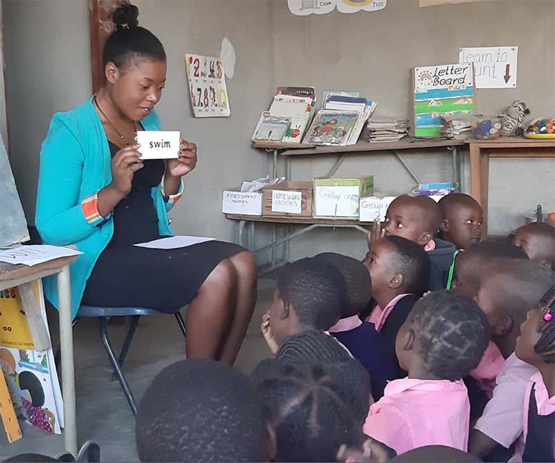 Teacher at Zambian school teaching children english