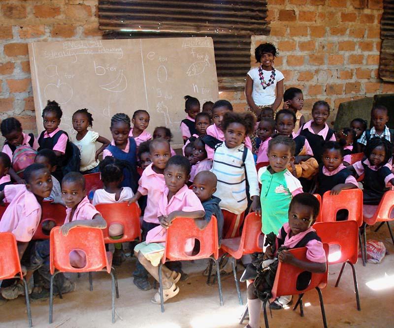 Group of Zambian children wearing pink shirts at school