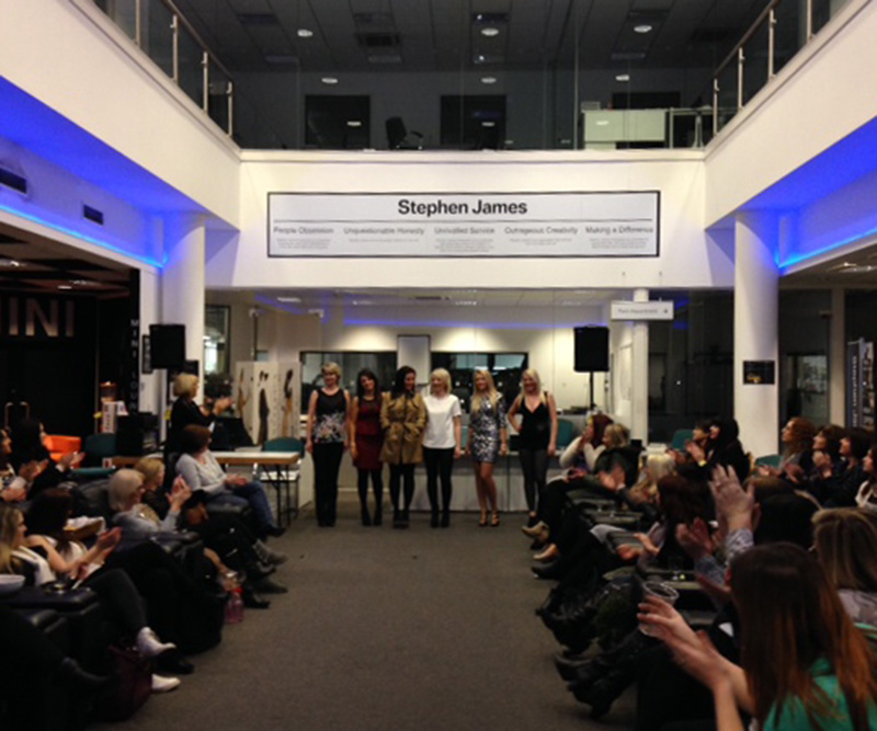 Group of women at a fashion show fundraising for Beyond Ourselves at Stephen James BMW