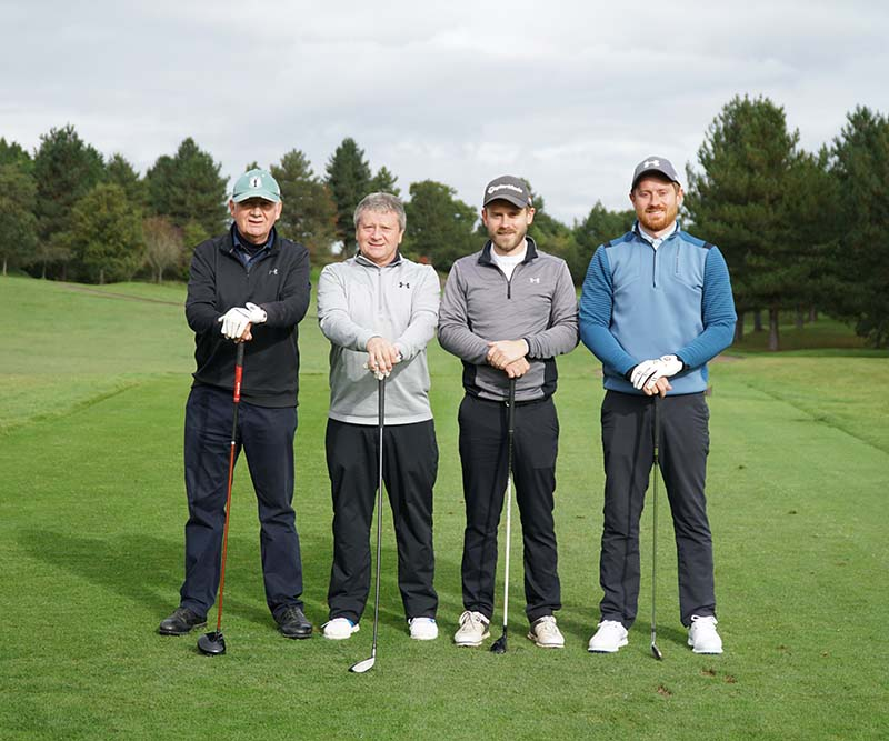 Four men getting involved by taking part in a golf day for Beyond Ourselves