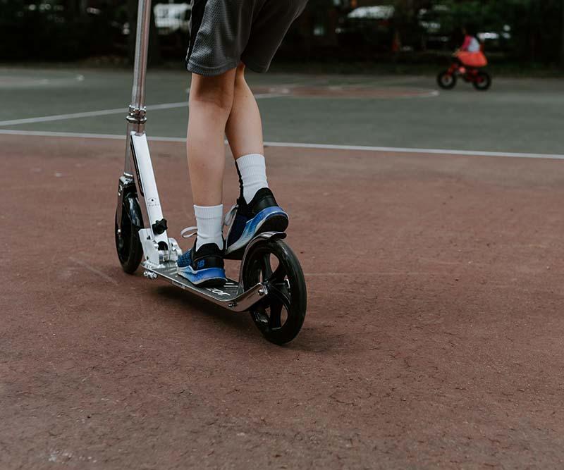 Boy enjoying playing on a scooter